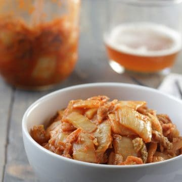 spicy red kimchi in a white bowl