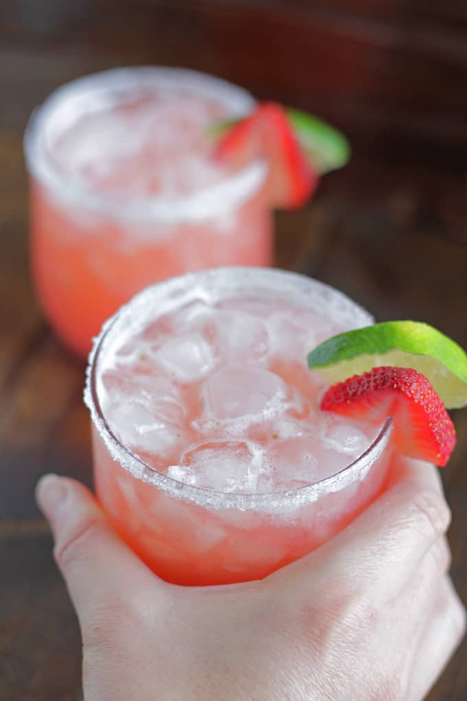 Strawberry Beer Margarita in a glass with slice of lime and strawberry