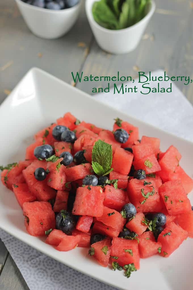 bowl with Watermelon and Blueberry Salad topped with mint