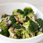 white bowl full of broccoli salad