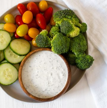 plate of vegetables with bowl of tzatziki sauce