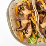 sauteed mushrooms on a taco with red pepper aioli