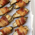 a pan of jalapenos wrapped in bacon and stuffed with dairy-free cream cheese