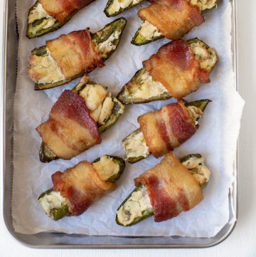 bacon wrapped jalapeno on a sheet pan