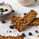 pinterest graphic of two paleo granola bars on table