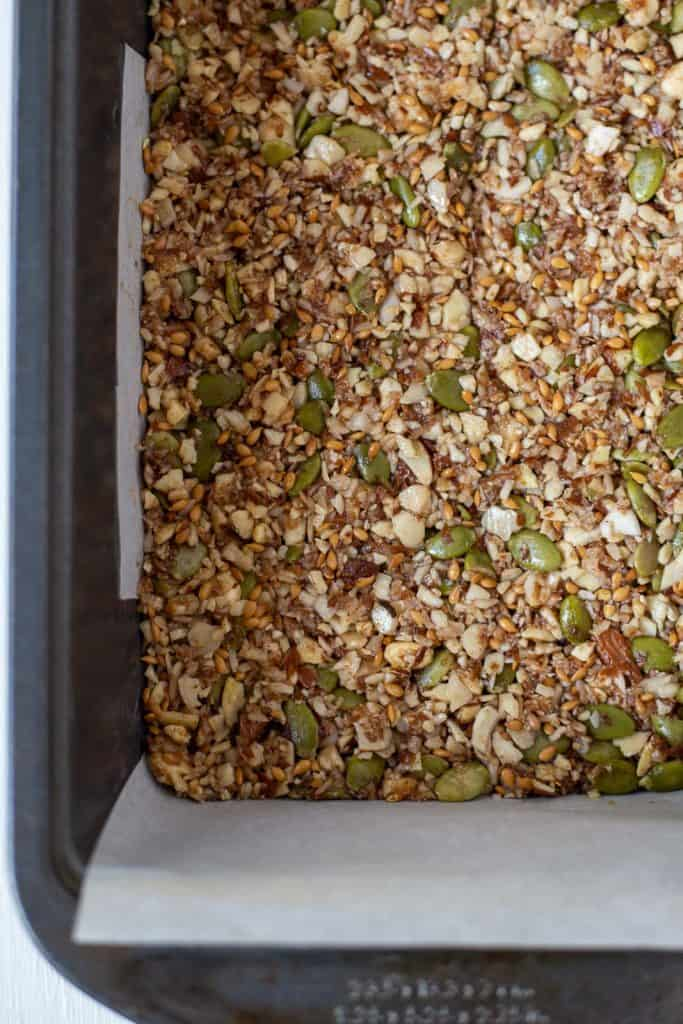 granola pressed in a baking dish ready for the oven