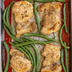 sheet pan with roasted chicken thighs and green beans