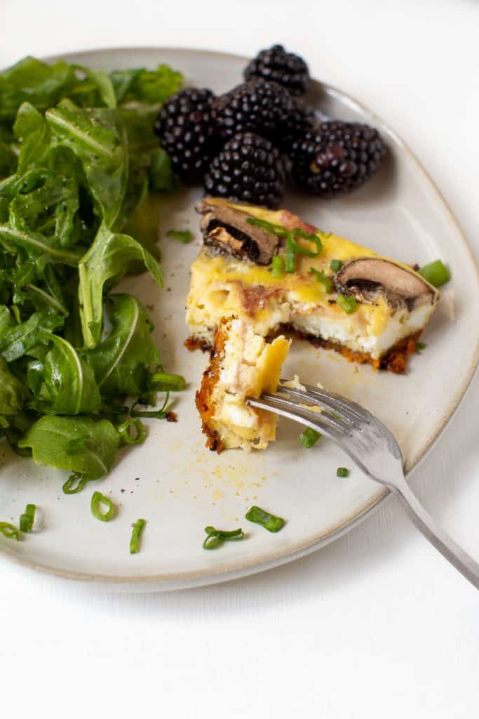 slice of frittata on a plate with fork