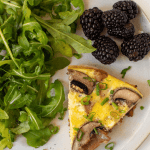 close up of a slice of egg frittata with berries