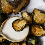 Pinterest graphic of plate of cooked brussels sprouts