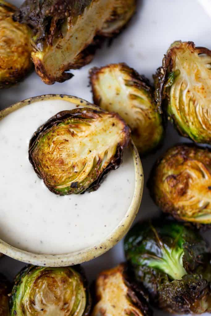 air fried brussels sprout dipped in ranch dressing