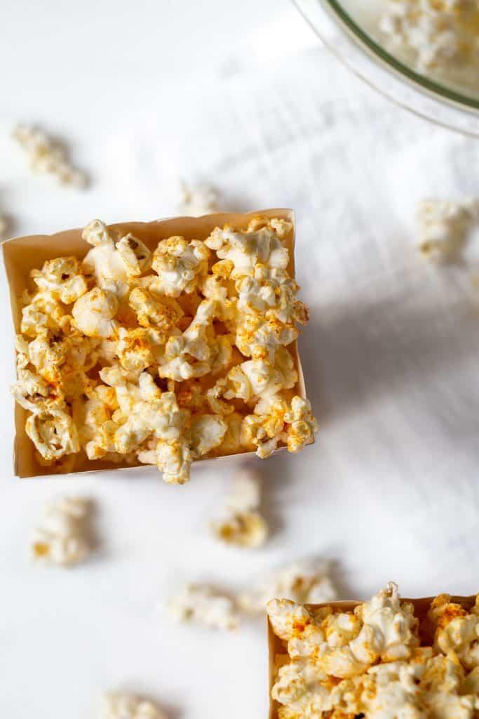 popcorn box full of seasoning popcorn on a table