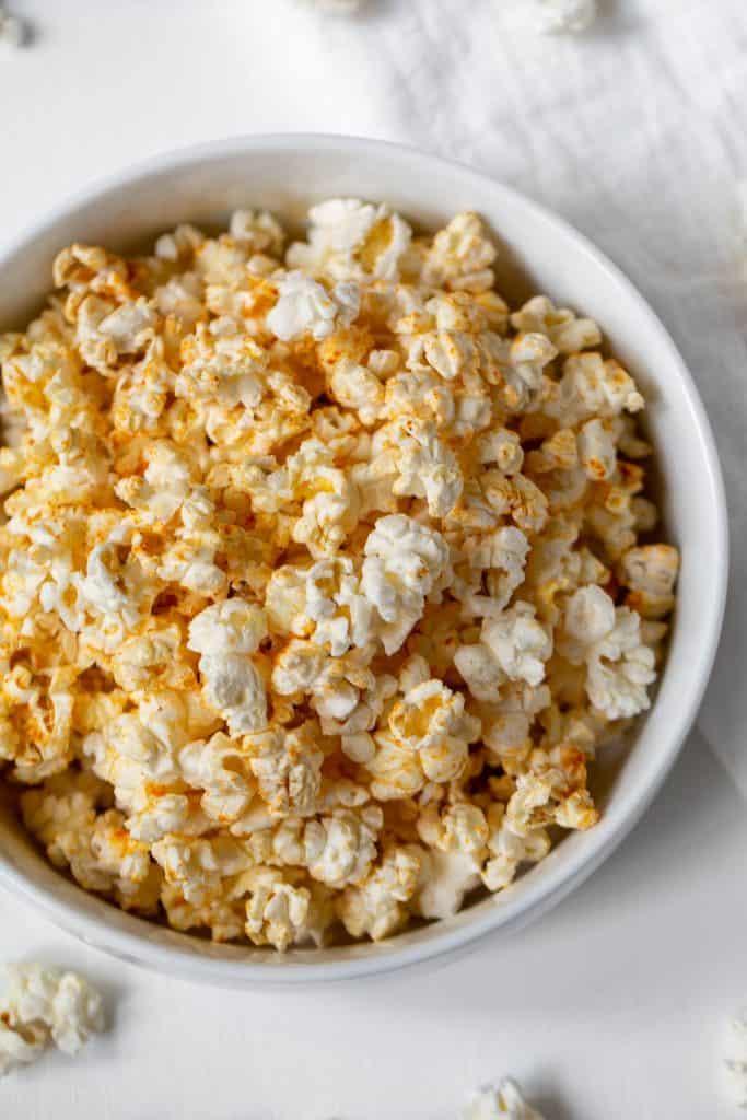 white bowl of seasoning popcorn