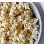 pinterest graphic of bowl of air-popped microwaved popcorn in a white bowl