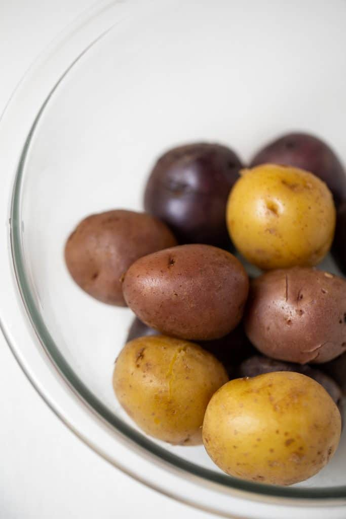 raw potatoes in a glass bowl