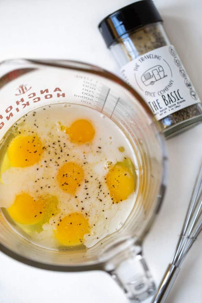 Glass bowl full of egg yolks and almond milk
