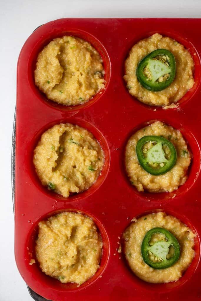 cornbread dough in muffin pan.