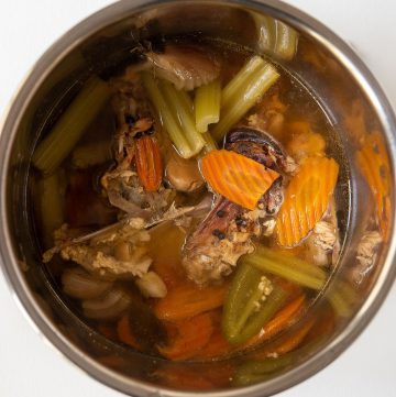 instant pot of cooked bone broth ingredients