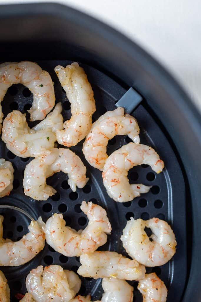 raw shrimp in an air fryer basket