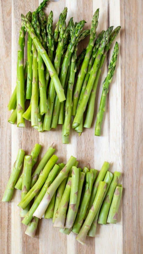 fresh asparagus on a cutting board.