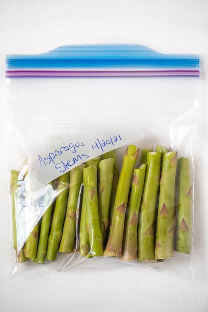 freezer bag full of asparagus stems